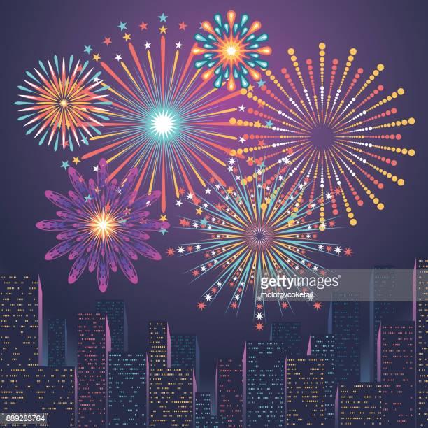 city skyline with firework display