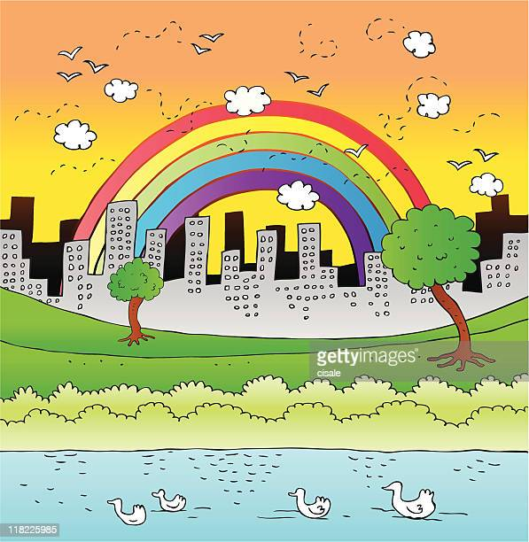 City Skyline,Park and rainbow with Ducks Swimming in Pond