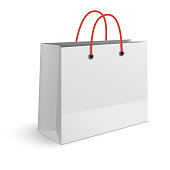 Classic paper shopping bag with red rope handles isolated