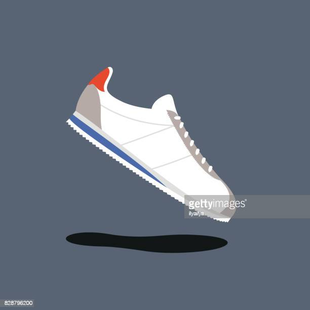 classic running shoes vector illustration - trainer stock illustrations