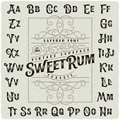 "Classic vintage decorative font set named ""Sweet Rum"" with label design template"
