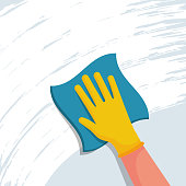 Cleaning napkin in the hands of a houseworker. Cleaning window.