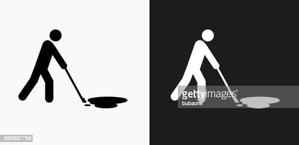 cleaning oil spill icon on black and white vector backgrounds - spill stock illustrations, clip art, cartoons, & icons