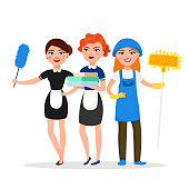 Cleaning service staff smiling cartoon characters isolated on white background. House cleaners dressed in uniform vector illustration in a flat style. Cute and cheerful maids and housekeeping concept.
