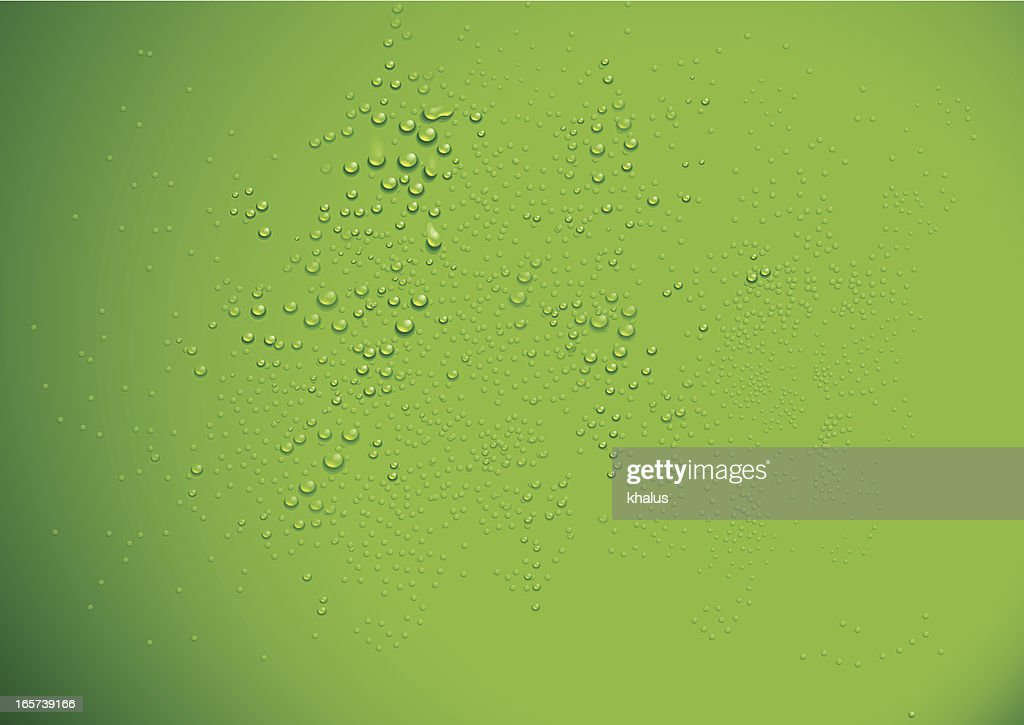 Clear water drops over a green background