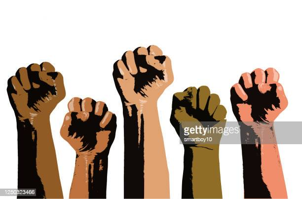 clenched fists held high - social justice concept stock illustrations