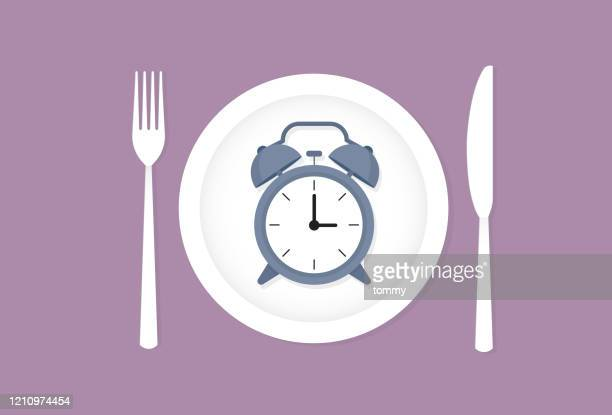 clock on a dish - fasting activity stock illustrations