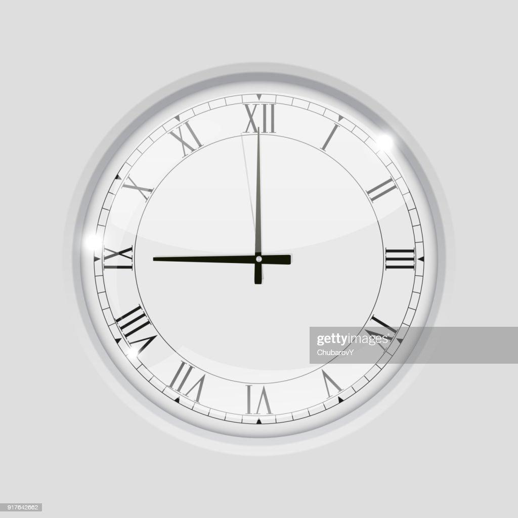 Clock with roman numerals. 9 o'clock