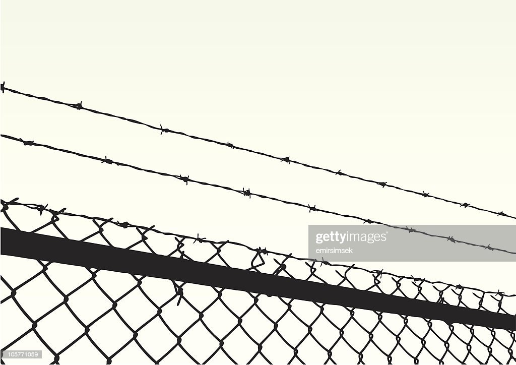 Close up of barbed wire at top of chain link fence