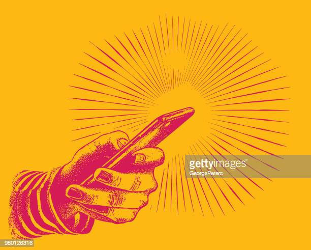Close up of hand holding smart phone