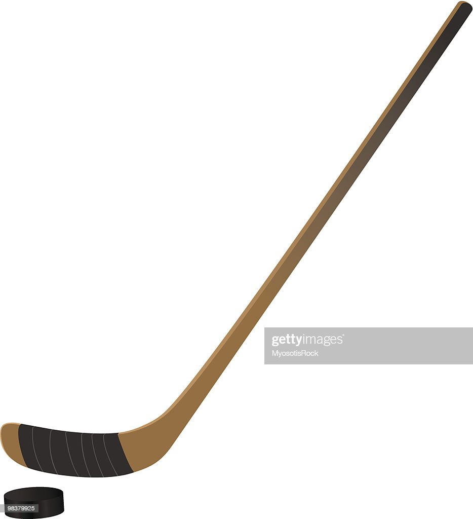 Close up of ice hockey stick and puck on white background