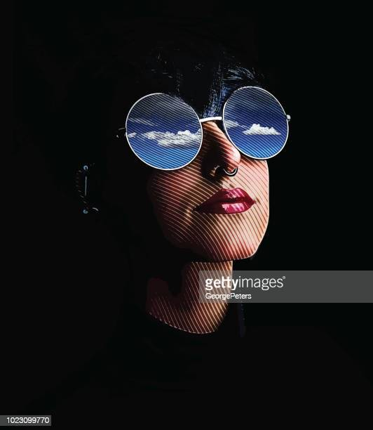 Close up of woman, sunglasses and reflection of sky and clouds