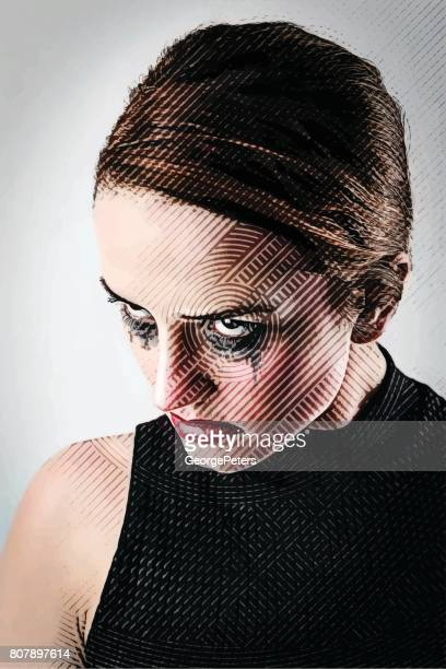 Close up portrait of an adult woman with an evil, vengeful facial expression