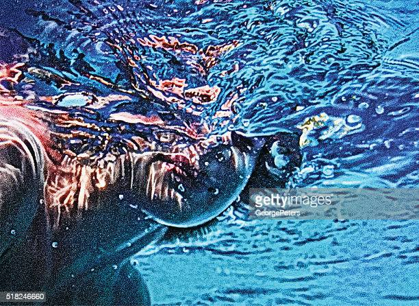Close Up Underwater View Of Boy Swimming