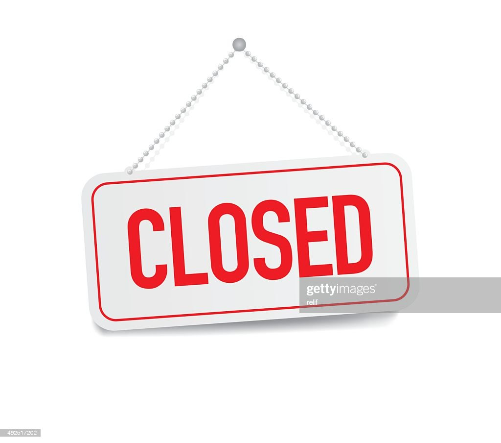 Closed sign hanging isolated on white wall