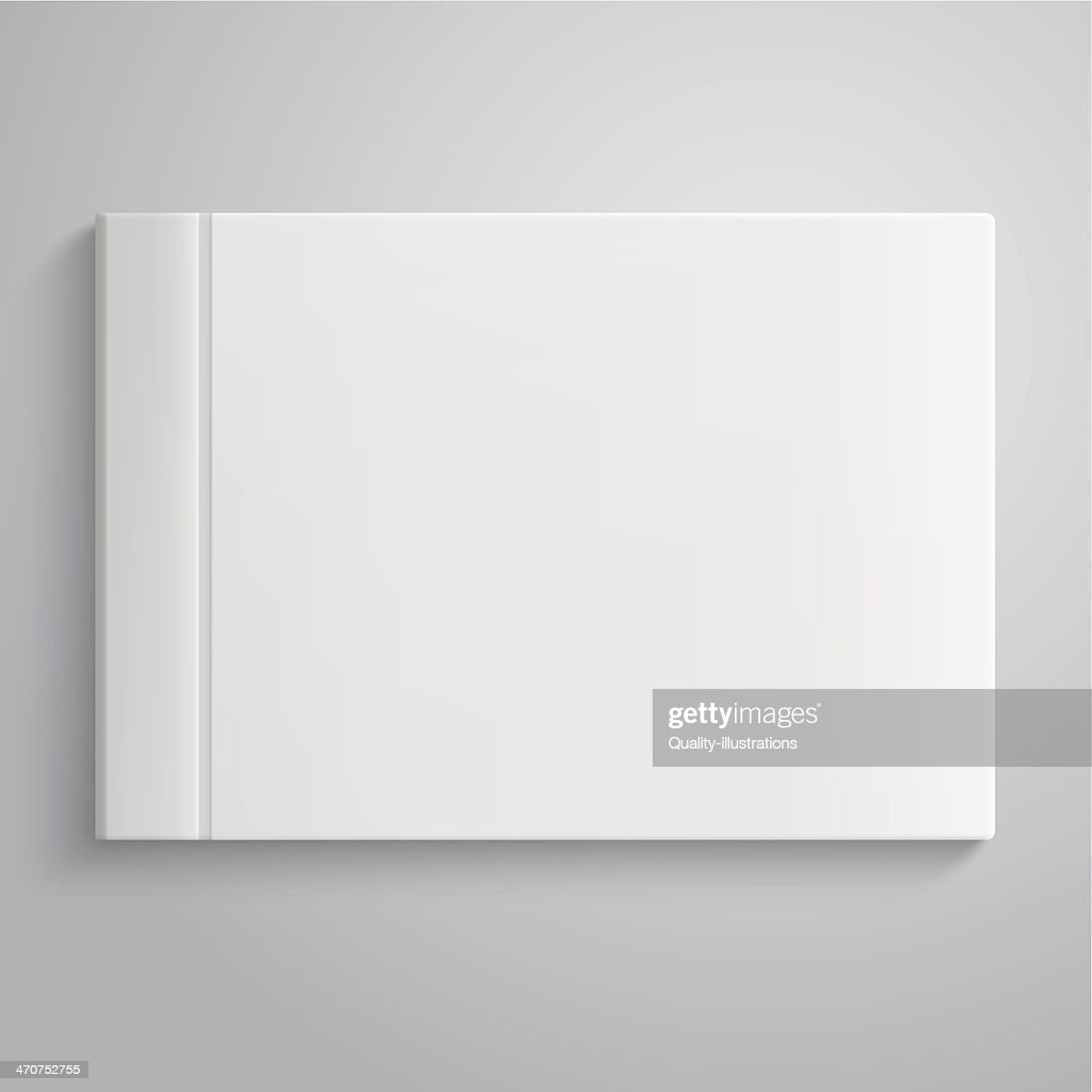 Close-up of a white closed hard copy photo album