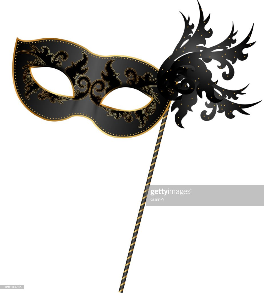 Close-up of black and gold masquerade mask