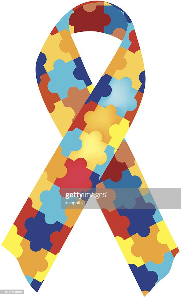 Close-up of colorful, puzzle-piece autism awareness ribbon