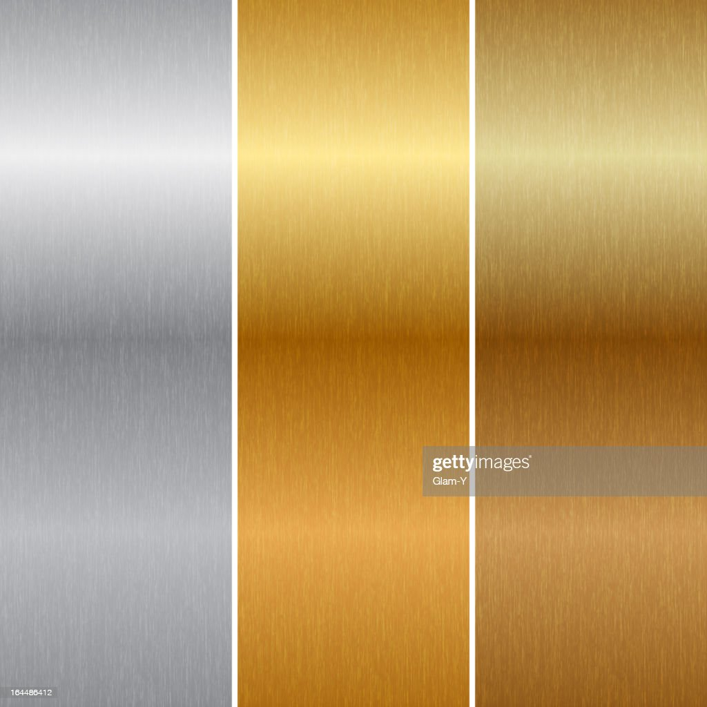 Close-up of metal background in gold, silver, and bronze