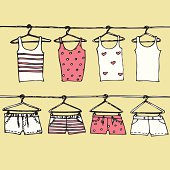 clothes on hangers. cute tank tops and shorts