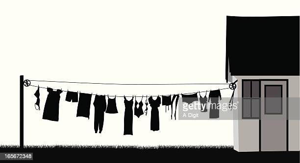 clothing line vector silhouette - clothesline stock illustrations