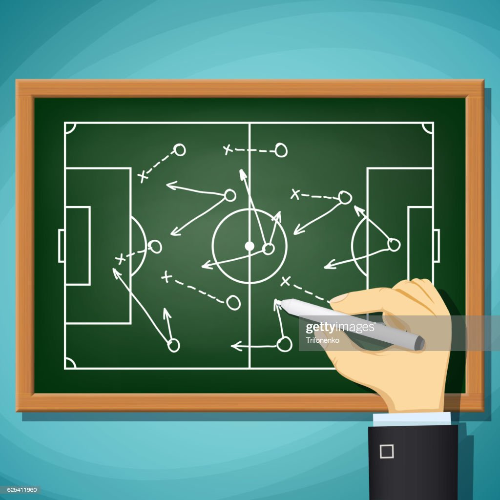 Coach draws tactics play in football.