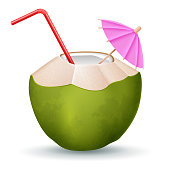 Coconut cocktail with straw and umbrella on white background