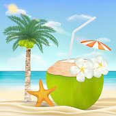 coconut water drink on a sea sand beach