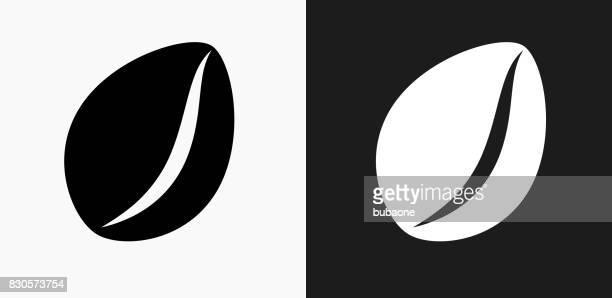 黒と白のベクトルの背景のコーヒー豆アイコン