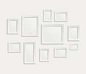 A collage of white picture frames on a white background