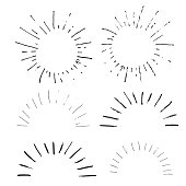 Collection of handdrawn sun bursts.
