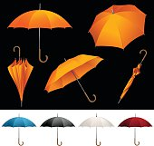 Collection of opened folded top view vector orange umbrellas