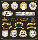 A collection of various golden badge and labels