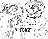 Collection of vintage SLR  cameras and retro photographic paper