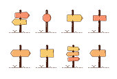 Collection set of wooden direction posts. Vector illustration icons with different roadpost styles.