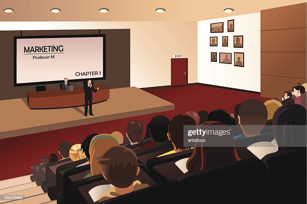 College students listening to the professor in the auditorium
