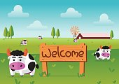 color flat farm of cows stand in green field with welcome wooden board.suitable for animal,agriculture,farm and livestock design jobs
