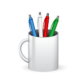 Colored pens in a glass, mug