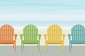Colorful Adirondack Beach Chairs on Boardwalk