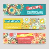 Colorful anniversary banners with fireworks