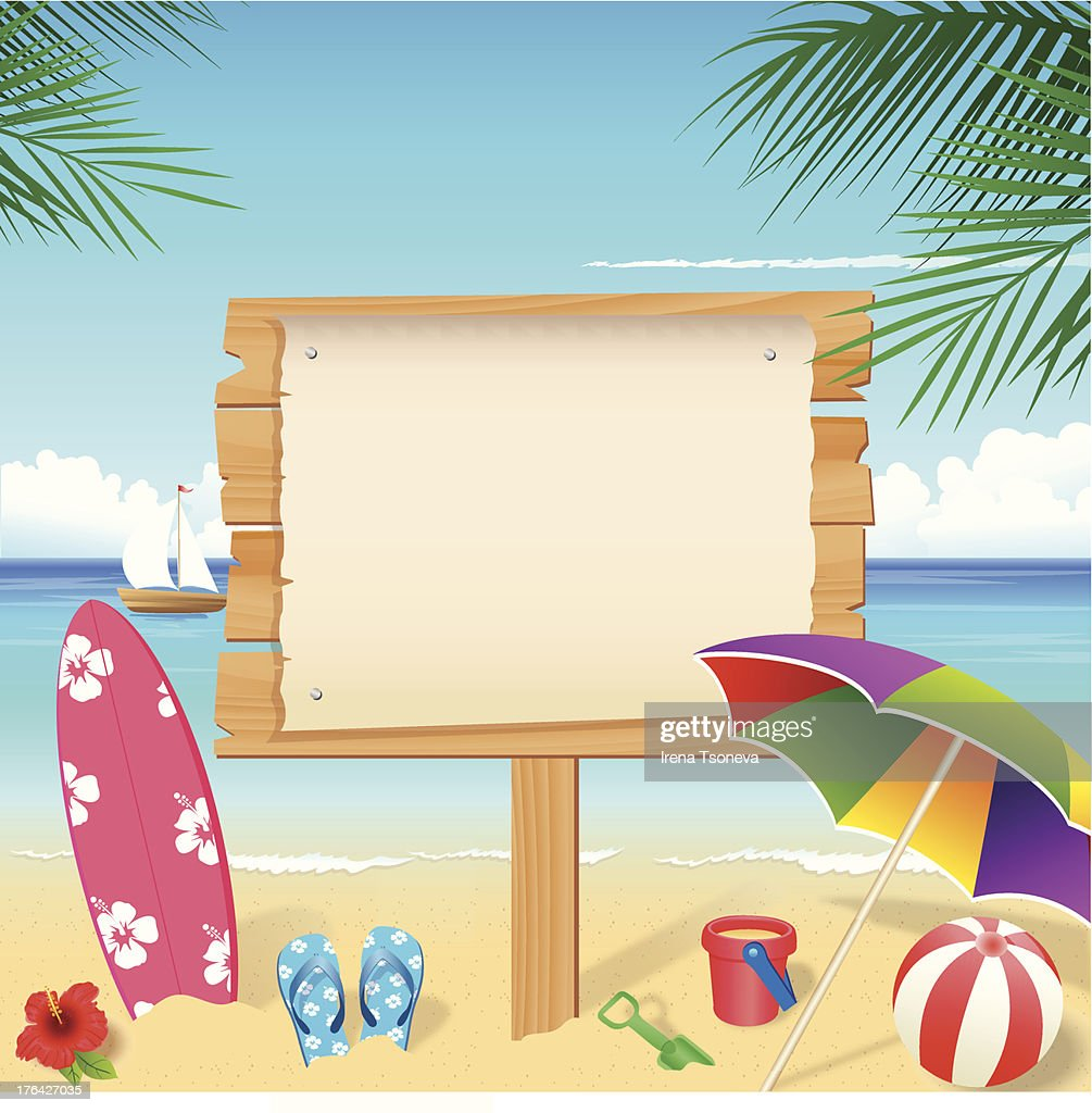 Colorful beach accessories with blank wooden sign