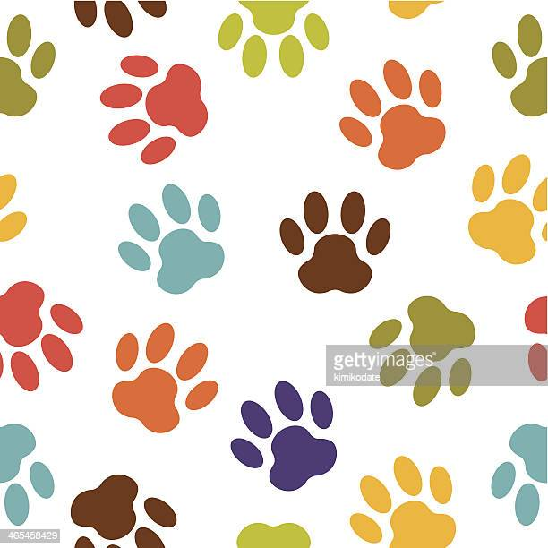 colorful dog paw print vector pattern - animal track stock illustrations, clip art, cartoons, & icons