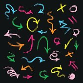 Colorful hand drawn direction arrows set on black background