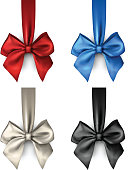 Colorful satin bows isolated on white.