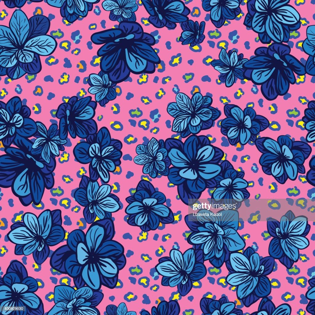 Colorful seamless pattern with leopard print and blue flowers