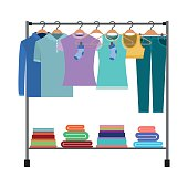 colorful silhouette of clothes rack with t-shirts and pants on hangers and fold clothes on bottom