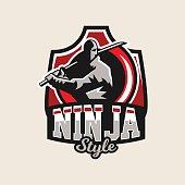 Colorful symbol, emblem, a ninja holding a katana in hand, isolated vector illustration.
