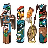 Colorful totems with faces of people and birds