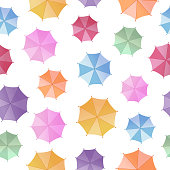 Colorful umbrellas. Seamless vector pattern on white background. View from above