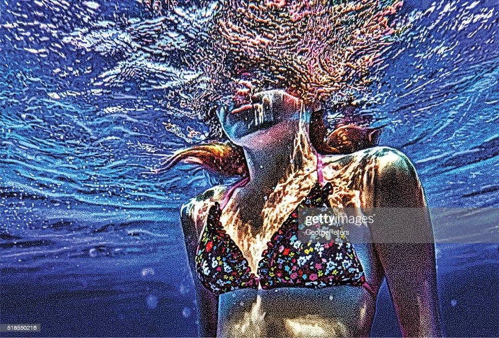 Colorful Underwater close up of young woman swimming